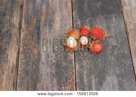 rambutan sweet fruit fresh on wood background