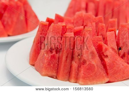Water Melon Slices In Dish On White Table