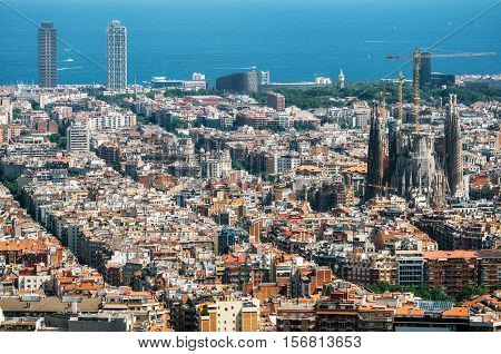 Barcelona Catalunia Spain - May 30 2015: Aerial view of Barcelona Mediterranean sea Sagrada Familia and The twin towers skyscrapers from Bunker El Carmel or Turo de la Rovira. Catalonia Spain.