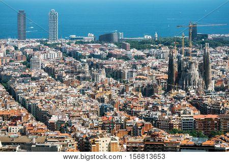 Barcelona Catalunia Spain - May 30 2015: Aerial view of Barcelona Mediterranean sea Sagrada Familia and The twin towers skyscrapers from Bunker El Carmel or Turo de la Rovira. Catalonia Spain.
