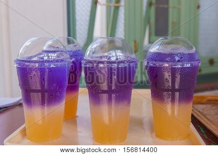 Butterfly Pea Juice With Soda Soft Drinks In Plastic Cups