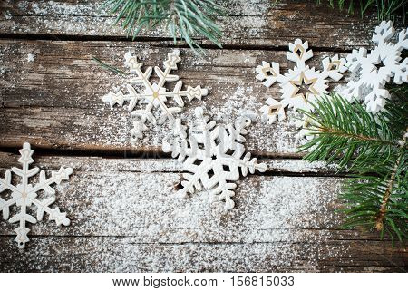 Christmas Decotative Decor White Snowflakes with Fir tree on Craked Wooden Table