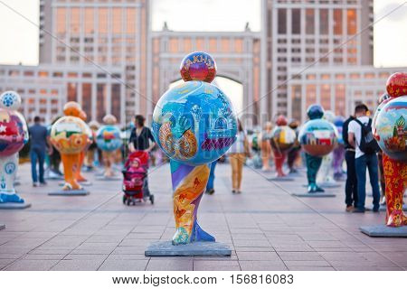 ASTANA, KAZAKHSTAN - August 03, 2016: Art installation in the form of sculptures symbolizing the a countries of the world