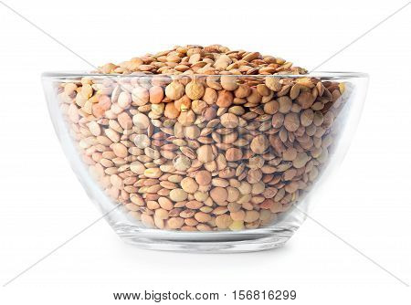 dry lentils in glass bowl isolated on white background. Uncooked grains of lentil. Bowl of brown lentils