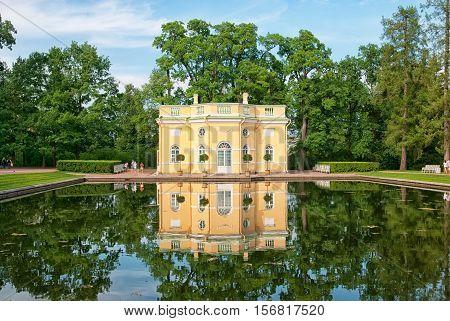 TSARSKOYE SELO, SAINT - PETERSBURG, RUSSIA - JULY 25, 2016: The Upper Bathhouse Pavilion and Mirror Pond in Catherine Park. The Tsarskoye Selo is State Museum-Preserve. Located near Saint-Petersburg