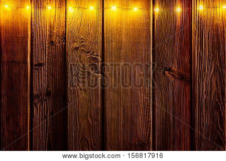 Christmas Lights On Wooden Rustic Background.