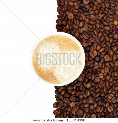 Coffee cup and beans on white background top view. Disposable cup of coffee in the coffee beans. Copy space. Cup of coffee and coffee beans