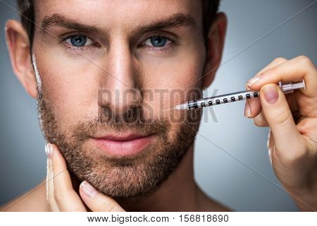 Man during surgery filling facial wrinkles