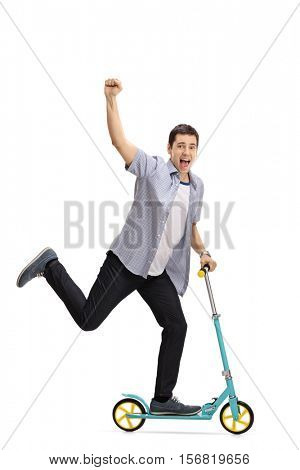 Full length portrait of an ecstatic young man riding a scooter and gesturing with his hand isolated on white background