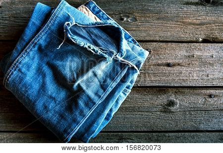 Neatly Folded Jeans On Wooden Background. Clothing, Fashion, Style, Lifestyle