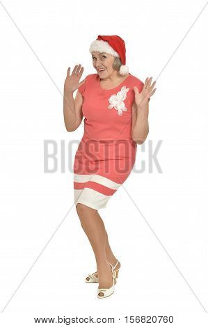 Full lenght portrait of happy  senior woman in Santa hat isolated on white background
