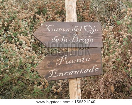 Signpost to the witches cave and the enchanted bridge outside village of Soportújar in Andalusia