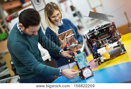 Engineering robotics class teamwork by young students