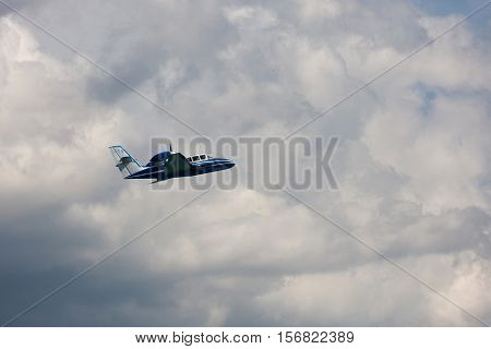 Flying Be-103 multipurpose light amphibian aircraft in clouds