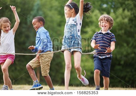 Interracial group of kids arriving the finish line at a friendly race