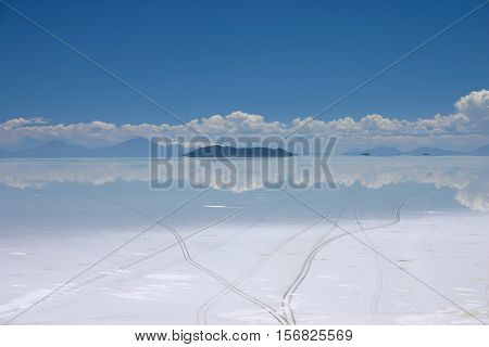 View of the salt lake of salar de uyuni in Bolivia showing tire tracks
