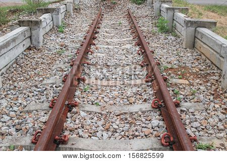 old railway track at station railhead : Select focus with shallow depth of field :