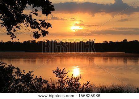 Soothing sunrise landscape on a golden pond