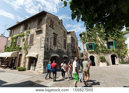 SIRMIONE ITALY - MAY 5 2016: Old house covered by ivy in Sirmione on Garda Lake Italy
