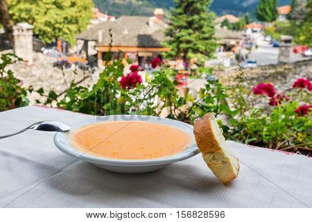 Dish of Fasolada (traditional Greek white beans soup) and bread. Metsovo Epirus Greece