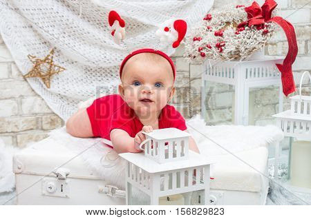 Christmas Baby. Little Cute Girl Five Months On The Eve Of Christmas.