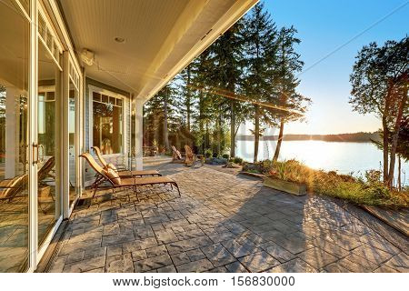 Large Stone Floor Patio Area Of Waterfront House