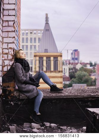 Business Woman Sitting On Building Rooftop. Suicide Concept Image
