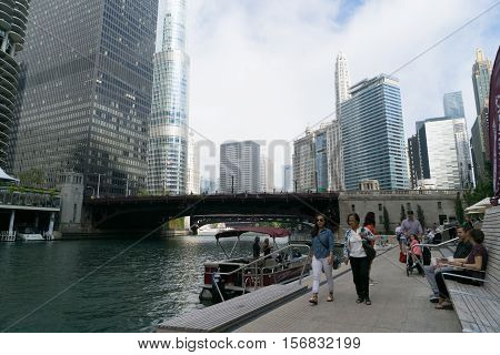 Chicago IL USA - September 25 2015: People are walking near Chicago river.