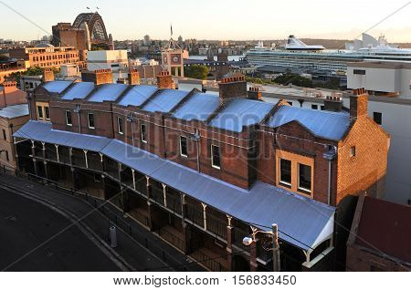 Sydney Australia - October 24 2016: Aerial urban view of old buildings rooftops at the historical area The Rocks with Sydney Harbour Bridge in the background in Sydney city center Australia.