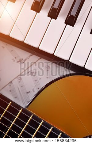 Piano And Guitar With Shine And Sheet Music Vertical Top