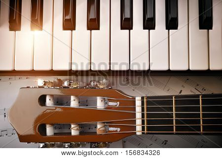 Piano And Tuning Peg Guitar And Sheet Music Background Top