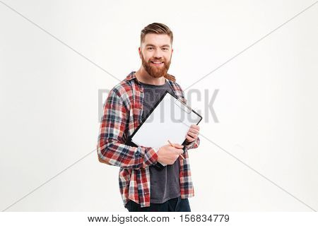 Portrait of a casual bearded man in plaid shirt holding clipboard isolated on a white background