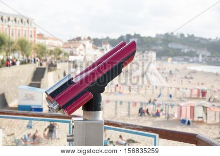 Tourist pink telescope for city exploring using for tourism