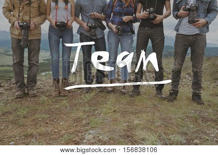 Team group of friends photographers on mountainds backdrop. Teamwork photography concept