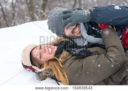 Couple Having Fun In Snow Covered Park