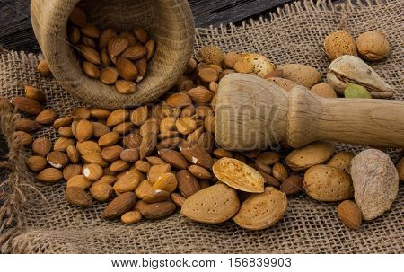 Almonds  on wooden background.almonds rashes on the board