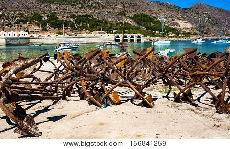 Bunch of rusty anchors in fisherman port in Favignana Sicily. Italy