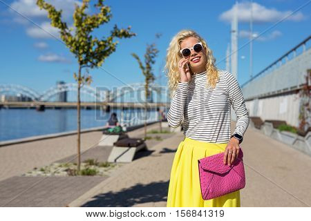 Fashionista talking on the phone while walking