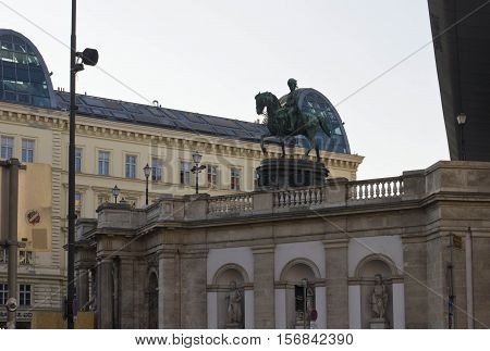 VIENNA, AUSTRIA - DECEMBER 31 2015: Architectural view of the equestrian statue of Franz Joseph and Albertina museum in Vienna at day time no people