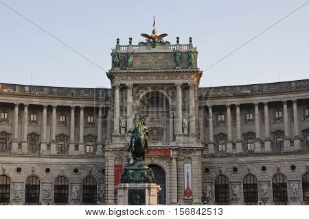VIENNA, AUSTRIA - DECEMBER 31 2015: Architectural close up of the facade of Hosburg Palace in Vienna with the equestrian statue of Prince Eugene of Savoy noboby around