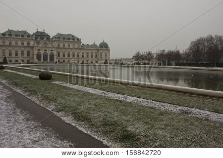 VIENNA, AUSTRIA - JANUARY 1 2016: Schloss Belvedere building and Park in Vienna in a snowy winter day with few people around