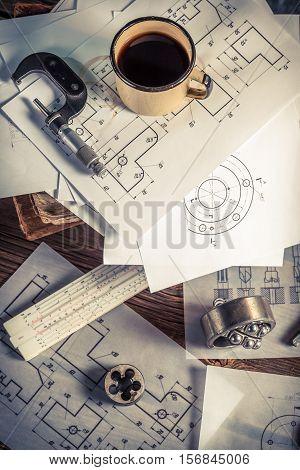 Desk Hardworking Engineer Mechanical Parts As Education Concept