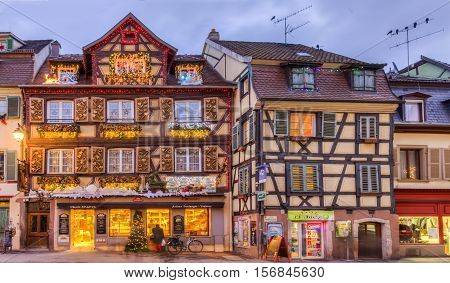 COlmarFrance- December 6 2013: Image of traditional Alsatian half-timbered houses decorated in winter holidays in ColmarFrance on December 62013.
