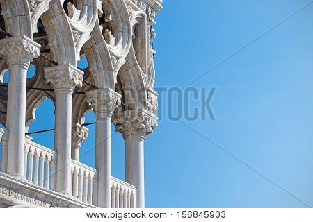 Detail of columns of the Doge's Palace in Venice with blue sky in the background. Free place for yout text is in the right side of the photo.