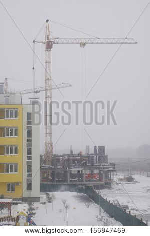 Construction of a multistory building in the harsh winter weather.