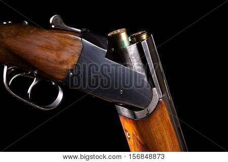 Opened double-barreled hunting gun with two cartridges