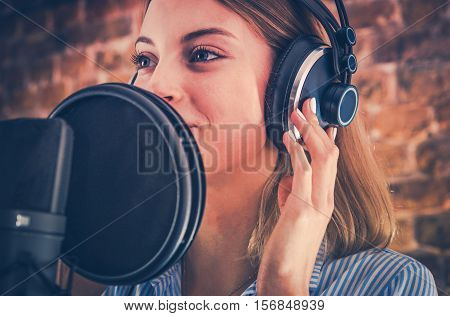 Woman Recording Audiobook. Audio Recording Studio Theme. Caucasian Voice Talent.