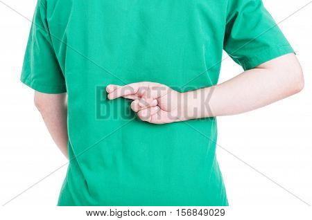 Back View Of Male Doctor Holding Fingers Crossed