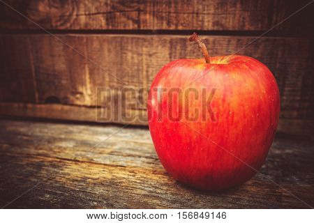 Fresh Tasteful Red Apple on the Wooden Table. Apple Fruit.