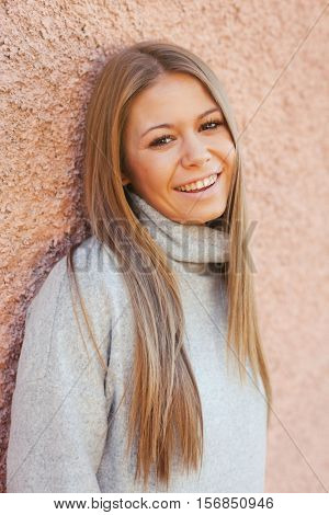 Casual young girl with a pink wall of background